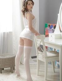 Elegant teen babe in stockings fucking a large dildo hard